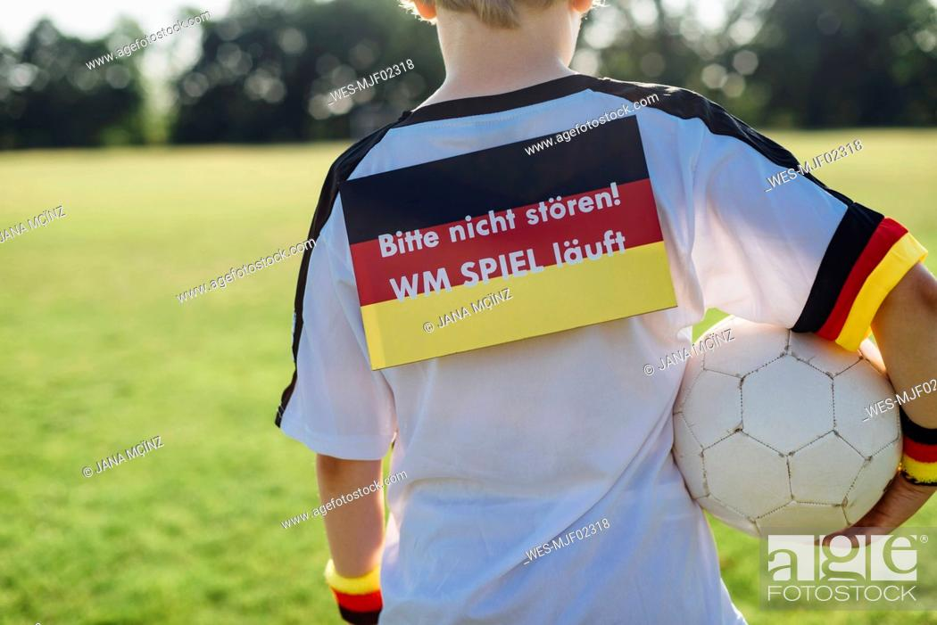 Stock Photo: Boy showing do not disturb sign due to soccer world championship.