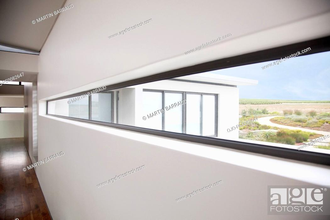 Stock Photo: View from long window in modern house.