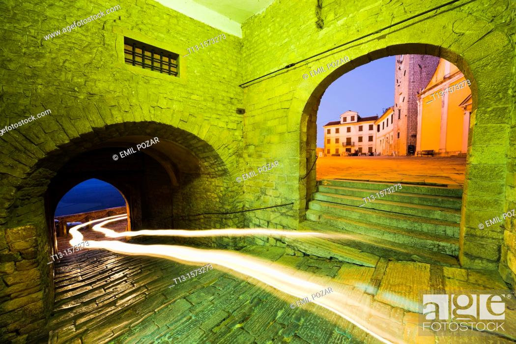 Stock Photo: Motovun medieval town in Istria, Croatia, long exposure with a car passing-by.