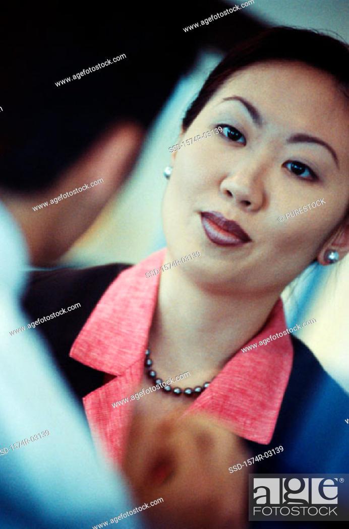 Stock Photo: Businesswoman talking to a businessman.