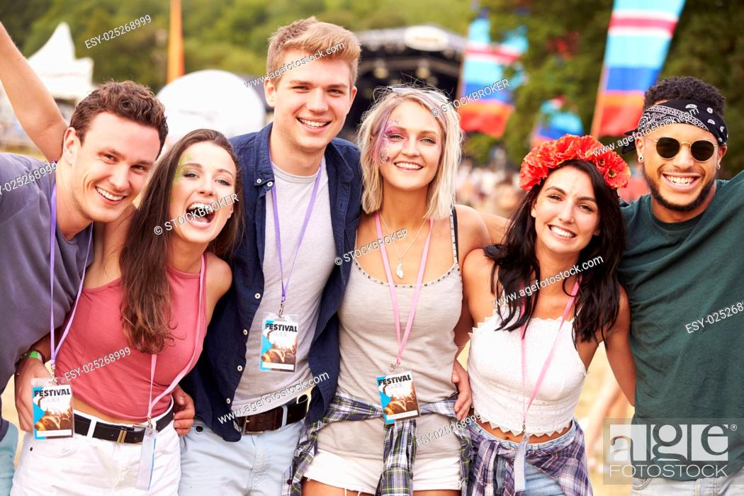Stock Photo: Group of friends hanging out together at a music festival.