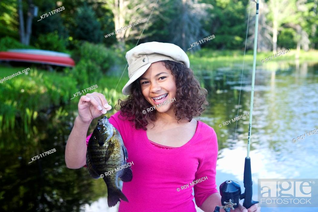 Stock Photo: Teen girl happy with her catch.