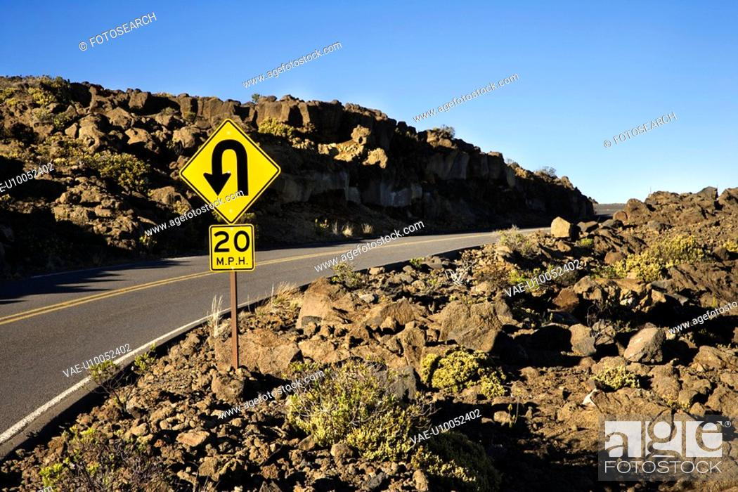 Stock Photo: Road and curve in road sign in Haleakala National Park, Maui, Hawaii.