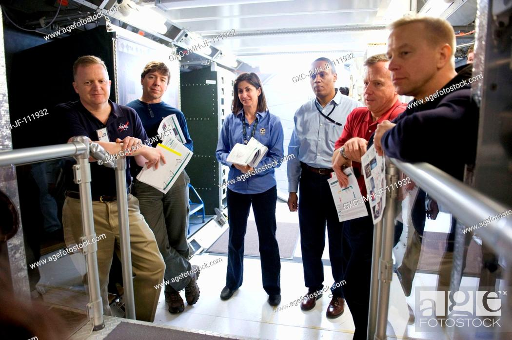 Stock Photo: STS-133 crew members participate in a training session in an International Space Station mock-uptrainer in the Space Vehicle Mock-up Facility at NASA's Johnson.