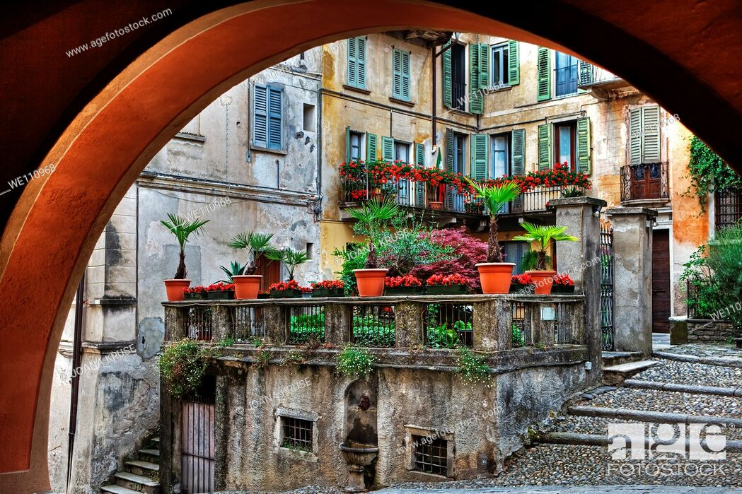 Stock Photo: Looking through an arch in old houses in the town of Orta in Piedmont, Italy.