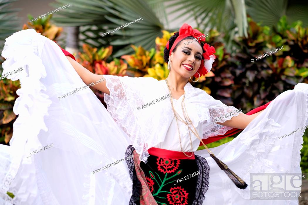 Stock Photo: Woman dancing - Puerto Vallarta, Jalisco, Mexico. Xiutla Dancers - a folkloristic Mexican dance group in traditional costumes representing the culture and.