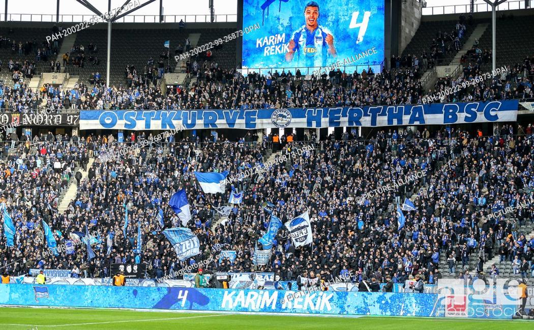 Stock Photo: 22 February 2020, Berlin: Football: Bundesliga, Hertha BSC - 1st FC Cologne, 23rd matchday, Olympic Stadium. Hertha's fans in the east bend welcome Karim Rekik.