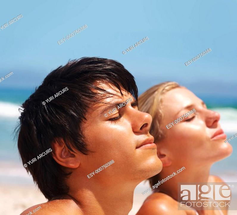 Stock Photo: Closeup of an attractive couple meditating at the beach.