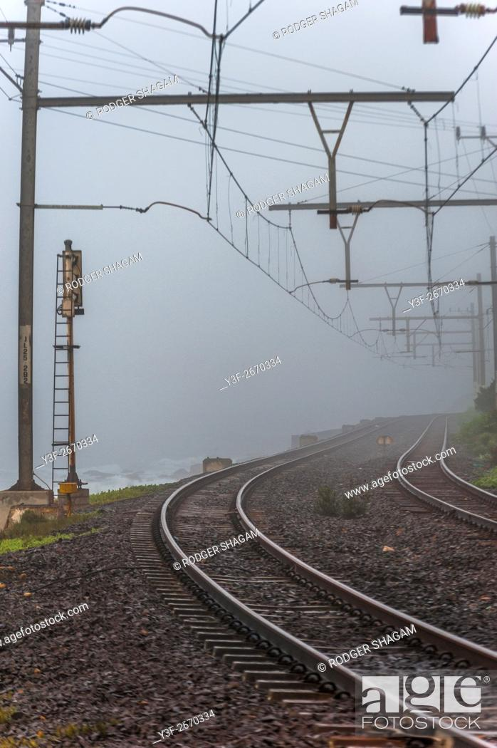 Stock Photo: Overhead gantries support high voltage electric cables on a railway. Cape Town, South Africa.