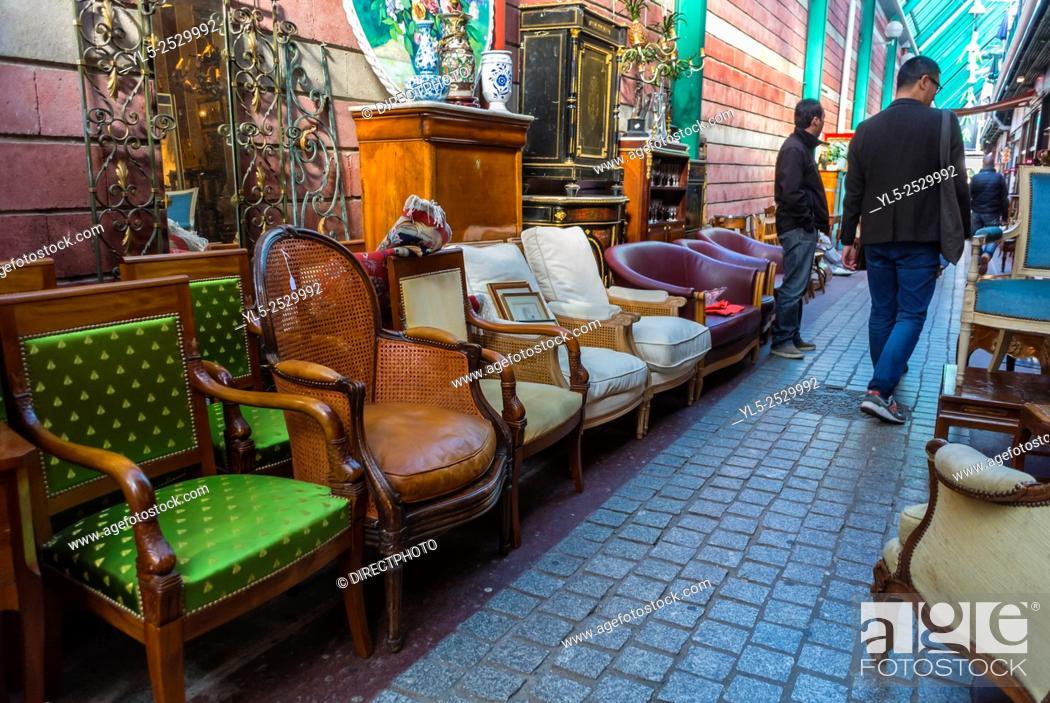 Stock Photo: Paris, France, Chinese Tourist Shopping in Saint Ouen, French Flea Market, Porte de Clignancourt, Antiques, Vintage Furniture.