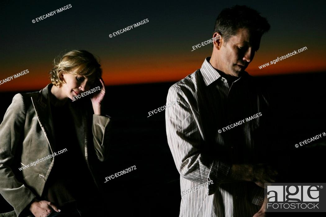 Stock Photo: Mature couple, woman with a headache.