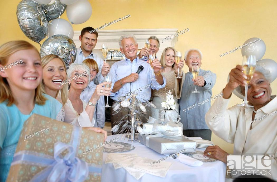 Stock Photo: Family and friends celebrating toasting Having a Party.