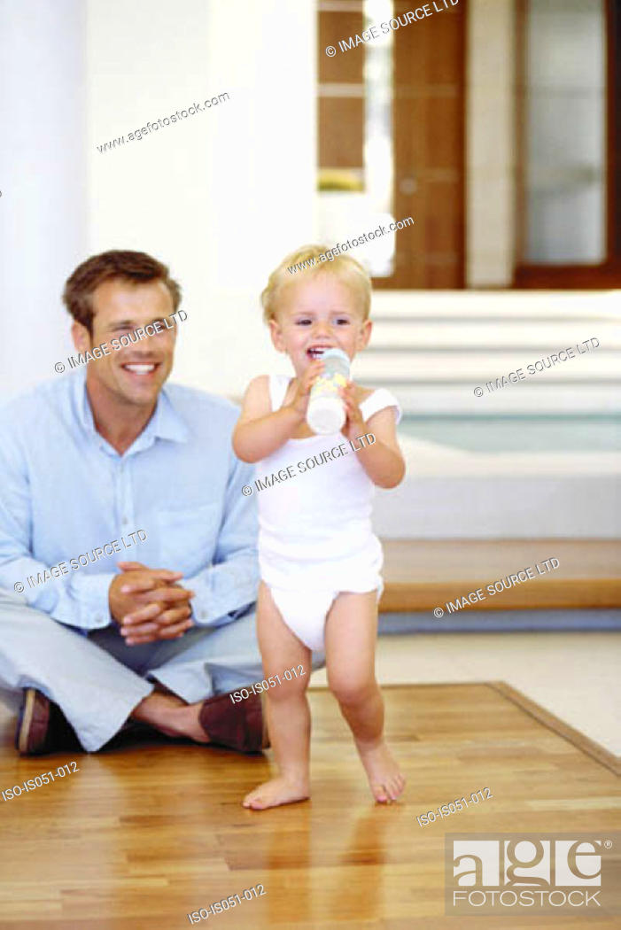 Stock Photo: Young dad with toddler.