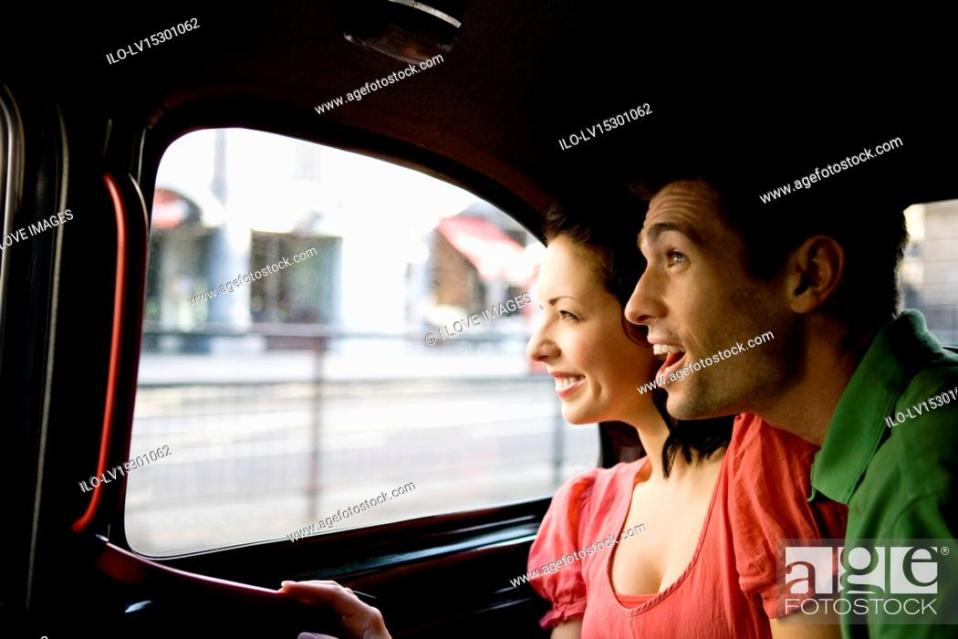 Stock Photo: A young couple in a London taxi, admiring the view.