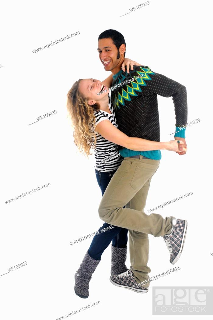 Stock Photo: Young couple dancing and having fun On white Background.