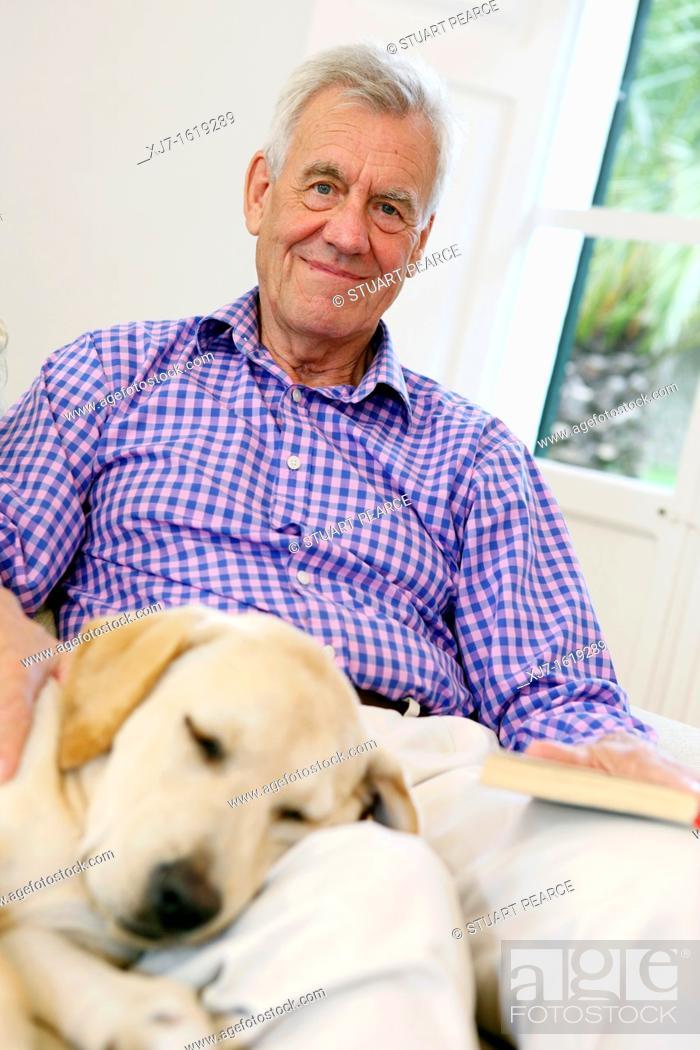 Stock Photo: Senior man with dog.