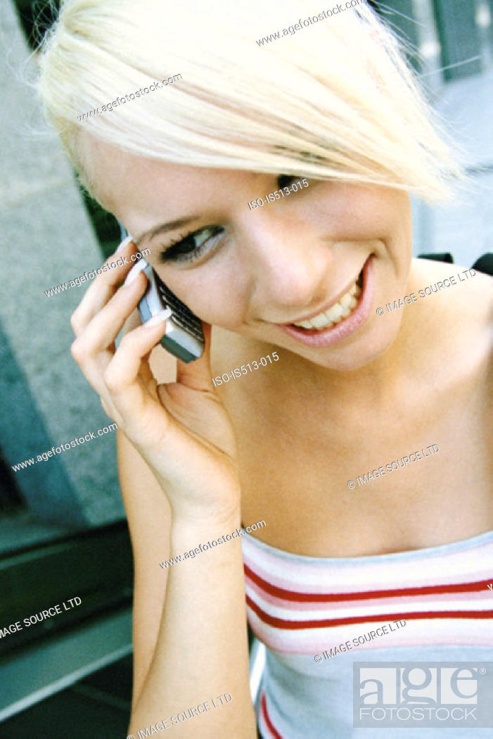 Stock Photo: Young woman on cellphone.