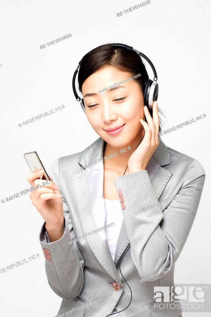 Stock Photo: businesswoman wearing headset.