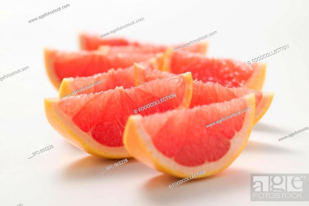 Stock Photo: Wedges of pink grapefruit.