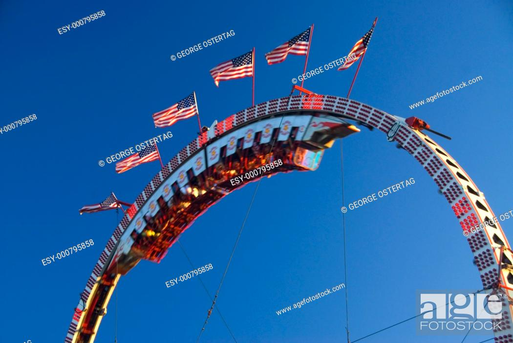Stock Photo: Super Loops carnival ride with flags, Oregon State Fair, Salem, OR.