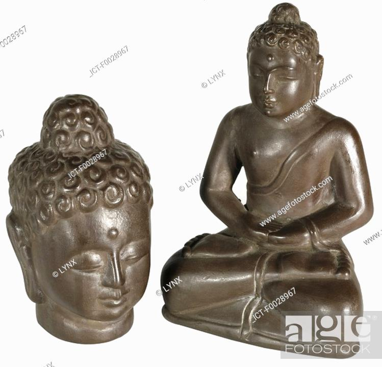 Stock Photo: World symbols: Buddha statuettes Tibet.
