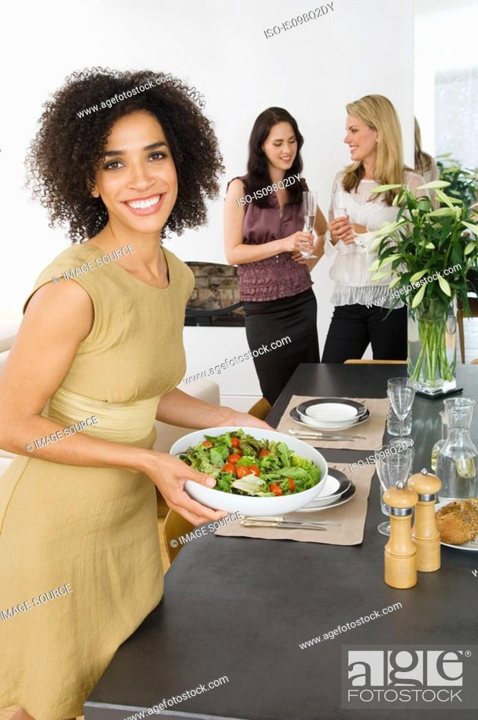 Stock Photo: Portrait of a woman holding a salad.