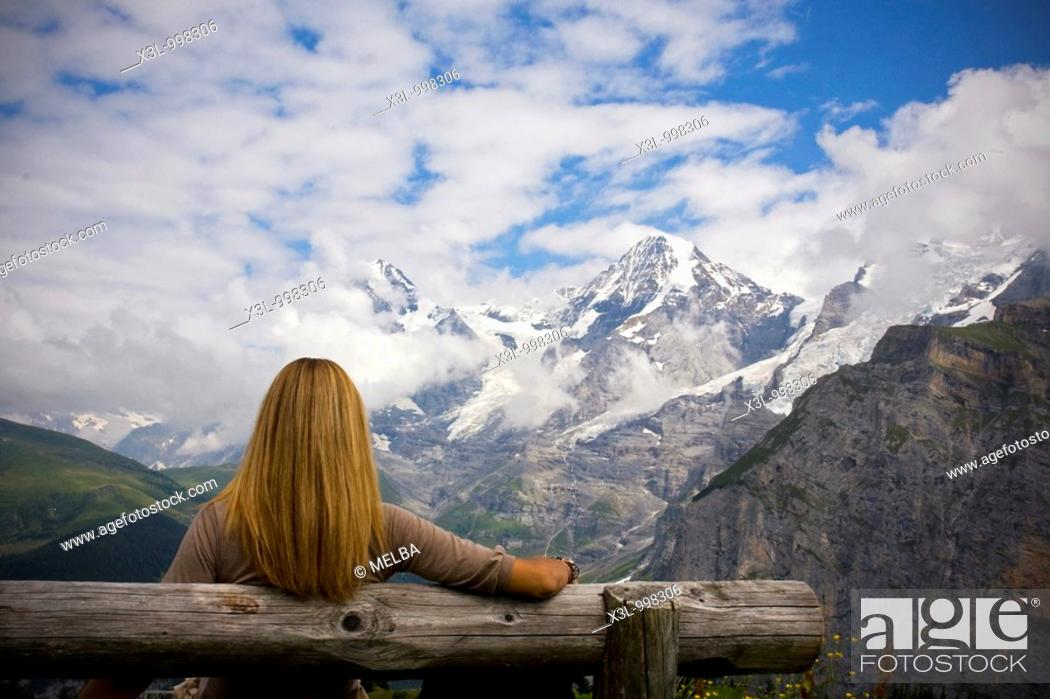 Stock Photo: Woman comtemplating Monch mountain  Murren  Switzerland.