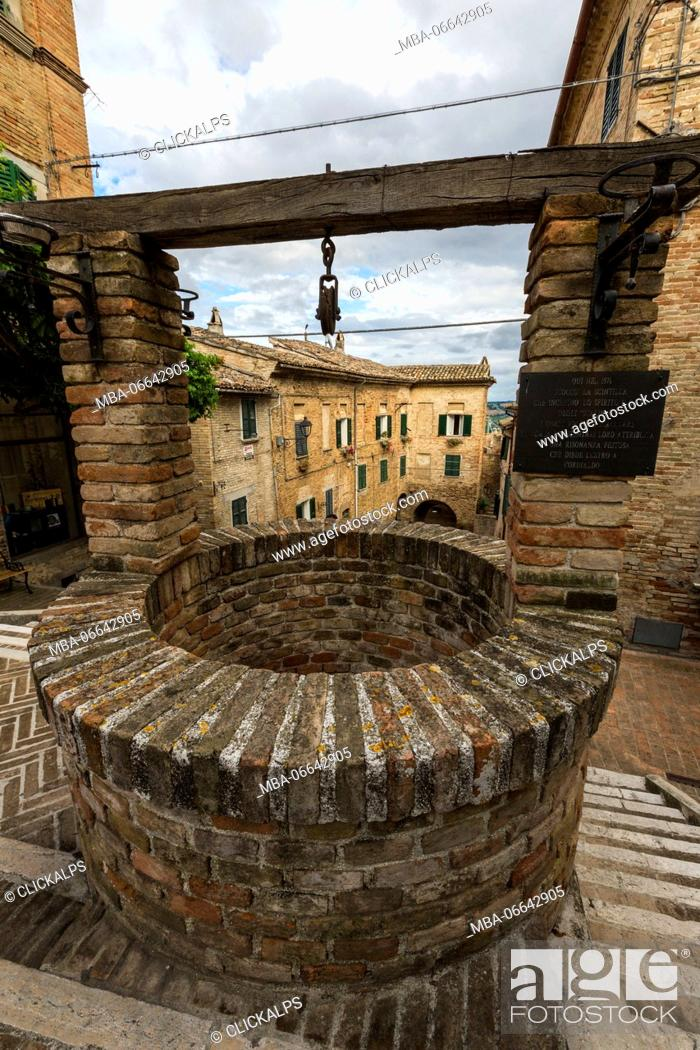 Stock Photo: The ancient stone well among the houses of the old town of Corinaldo Province of Ancona Marche Italy Europe.