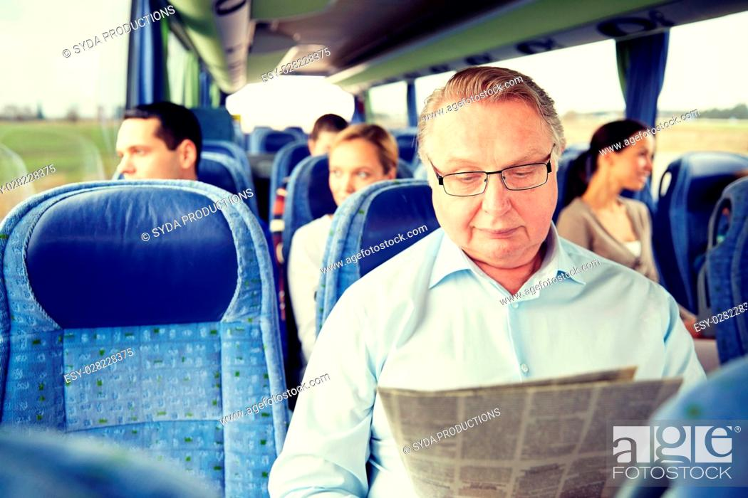Stock Photo: transport, tourism, trip and people concept - senior man reading newspaper in travel bus.