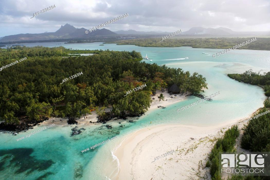 Stock Photo: Mauritius, aerial view from an helicopter, Stags island ile aux cerfs and Mangenie islet.