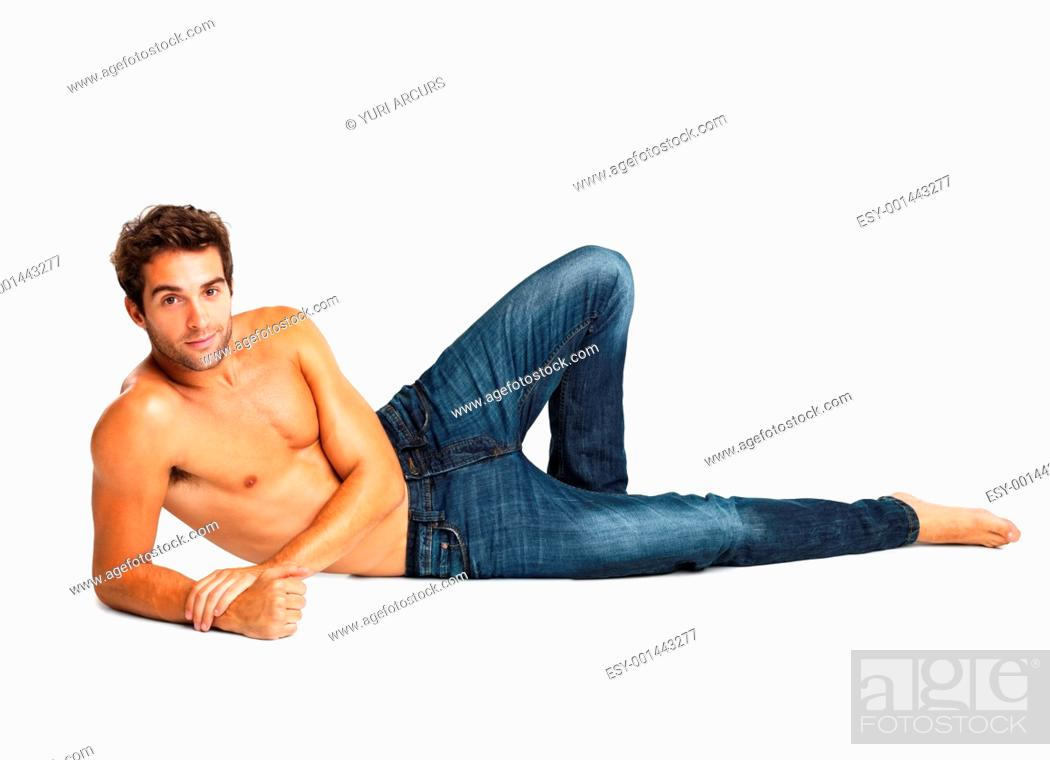 Imagen: Shirtless man relaxing in blue jeans isolated on white background.