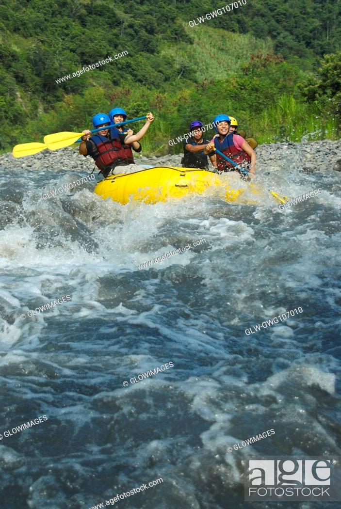 Stock Photo: Five people rafting in a river.