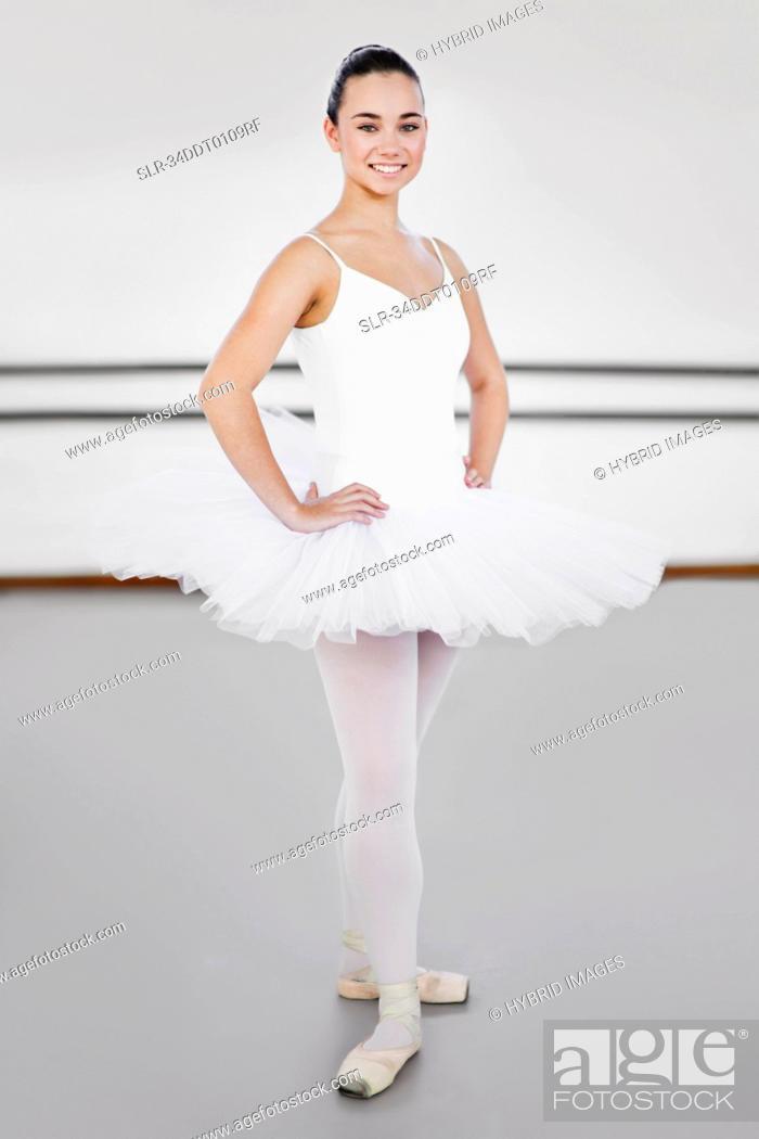 Stock Photo: Ballet dancer standing in studio.
