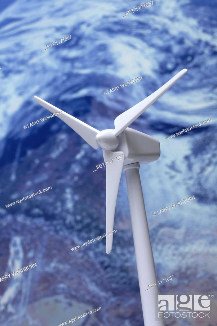 Stock Photo: A model of a wind turbine, planet earth in the background.