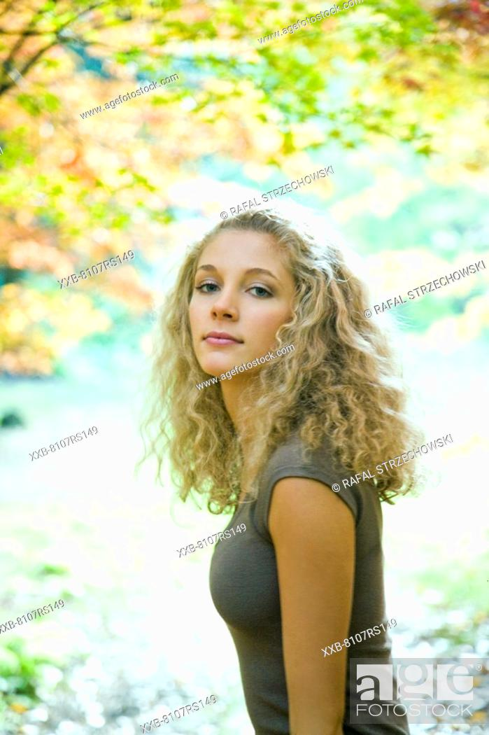 Stock Photo: Blond woman in park.
