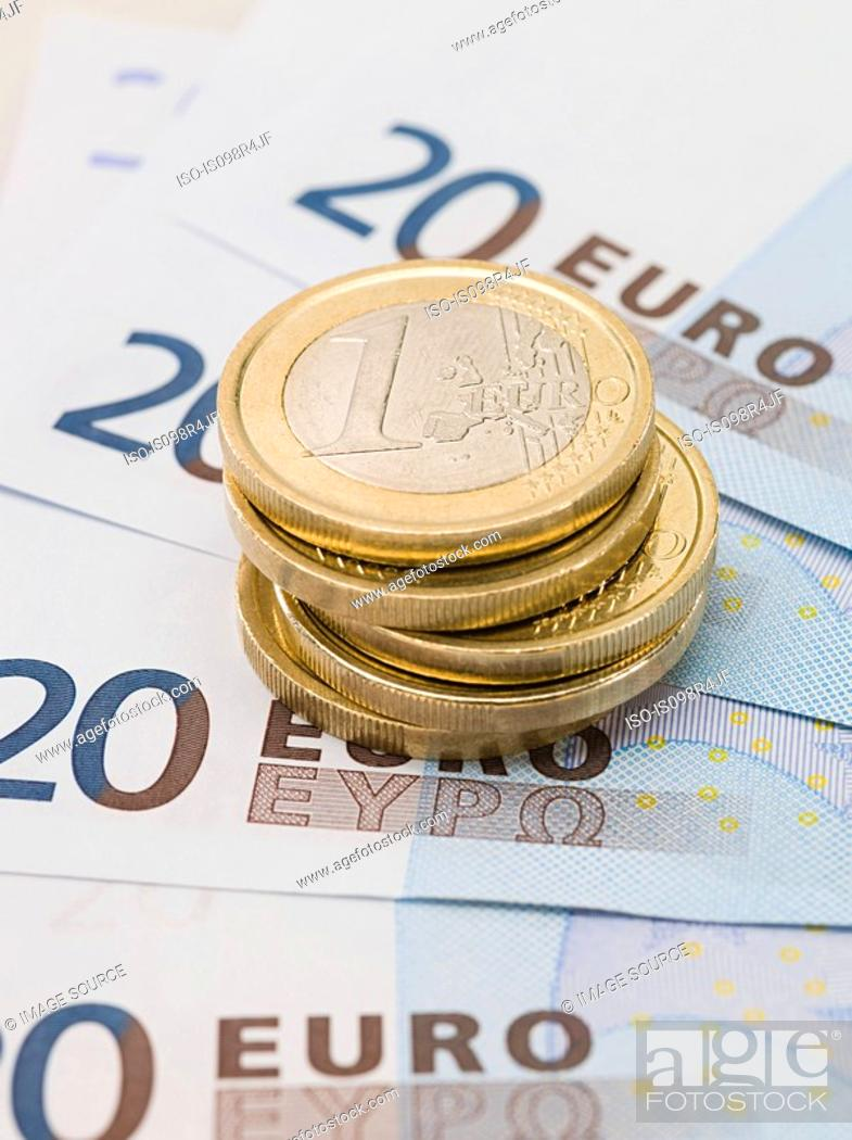 Stock Photo: Euro coins and banknotes.