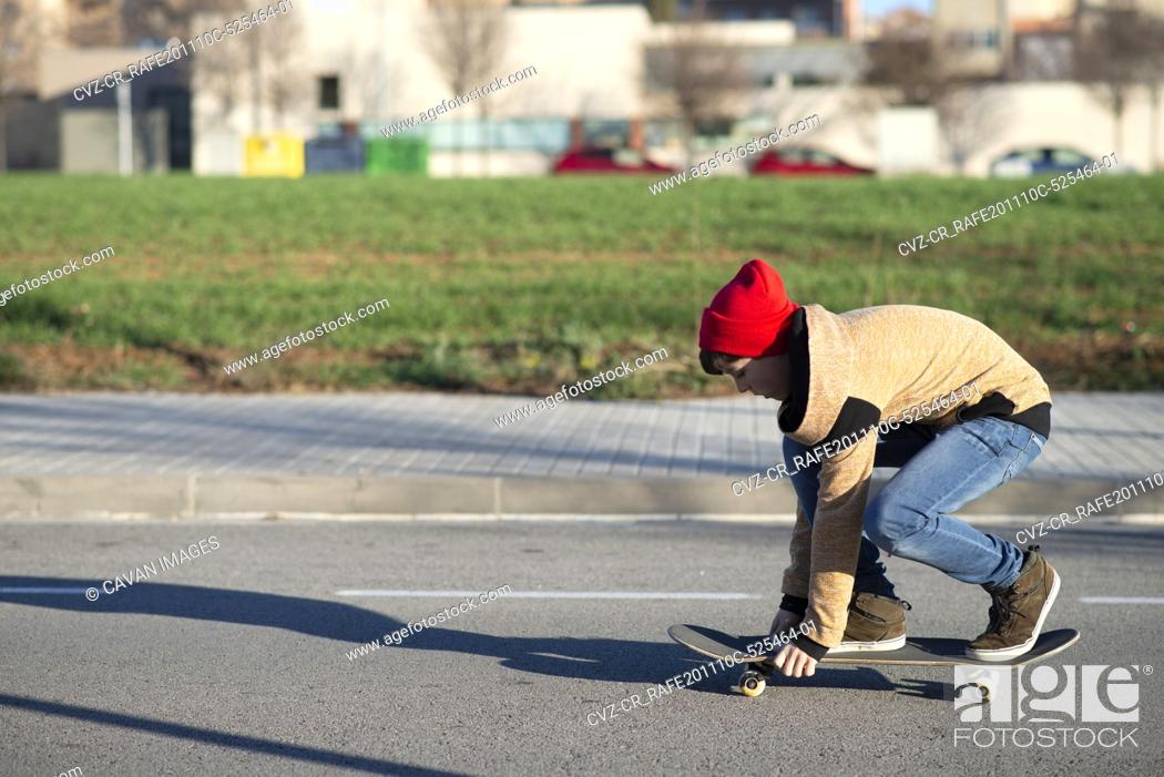 Stock Photo: Male skateboarder riding and practicing skateboard in city outdoors.