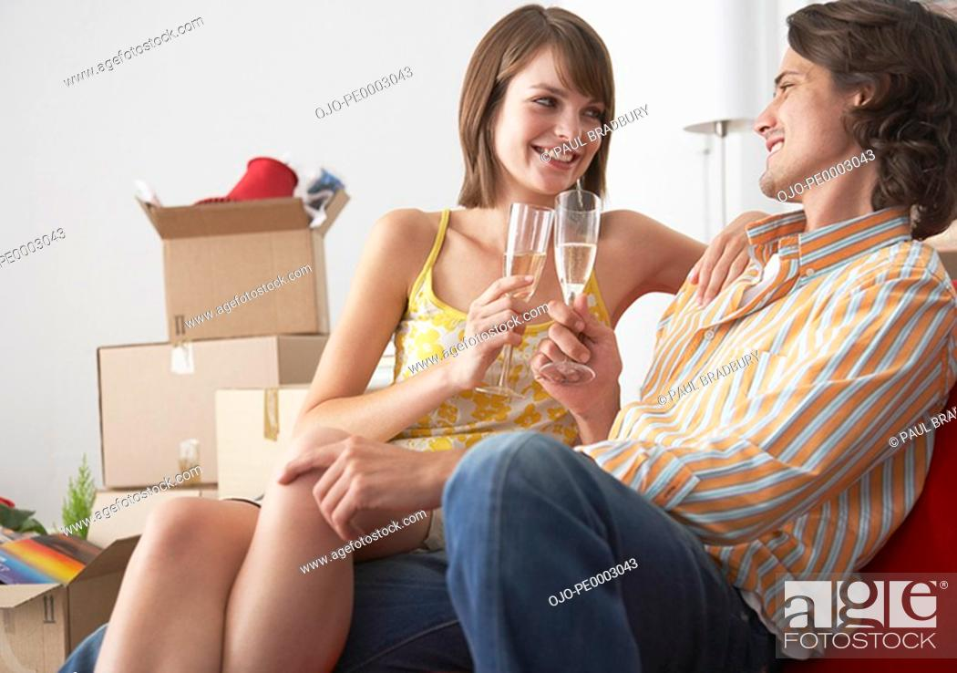 Stock Photo: Couple with champagne in house celebrating.