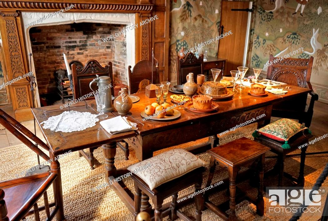 Stock Photo: Elizabethan dining table set with typical foods, at Blakesley Hall is a Tudor hall on Blakesley Road, Yardley, Birmingham, England. It dates to 1590.