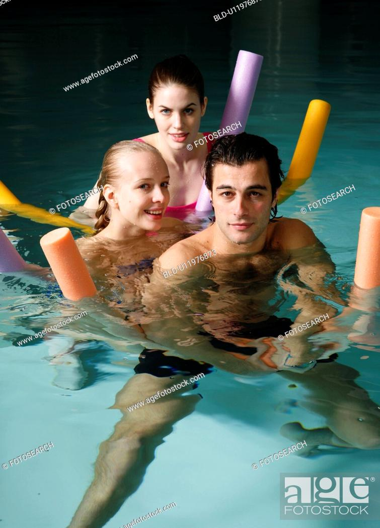 Stock Photo: People exercising in a spa pool.