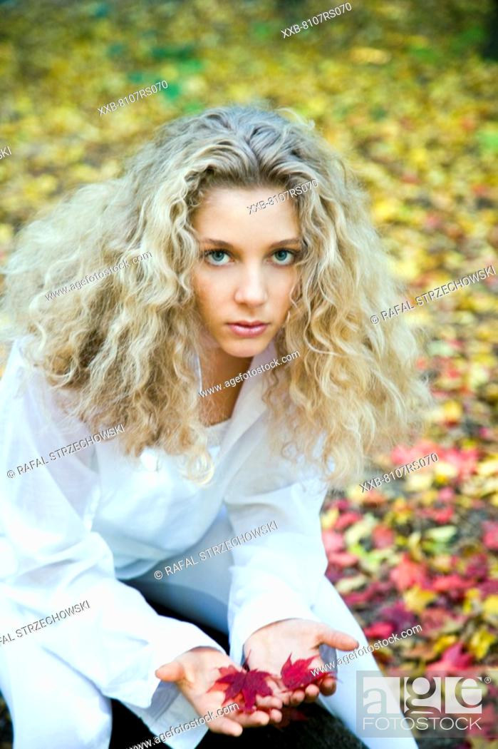 Stock Photo: Young woman with autumn leaves.