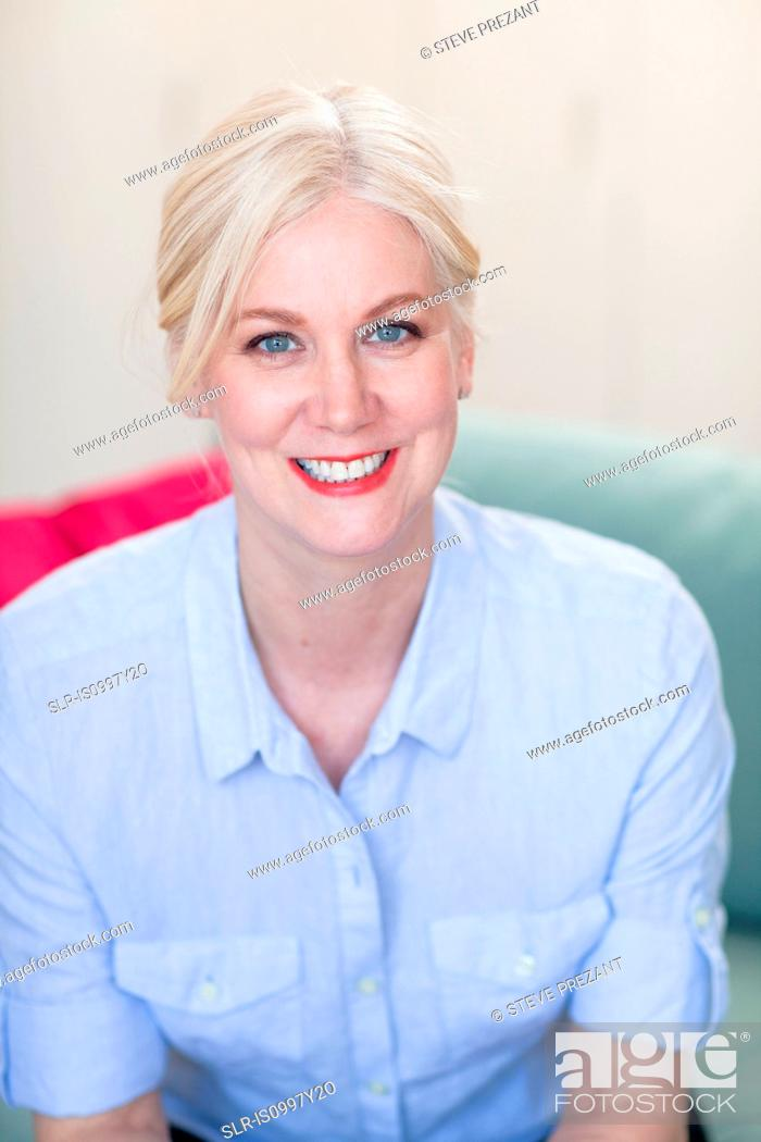 Stock Photo: Portrait of a mature woman with blond hair and blue eyes.