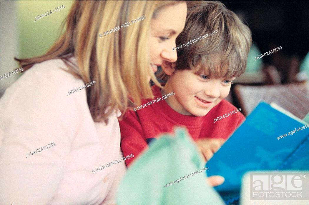Stock Photo: mother and son reading together.