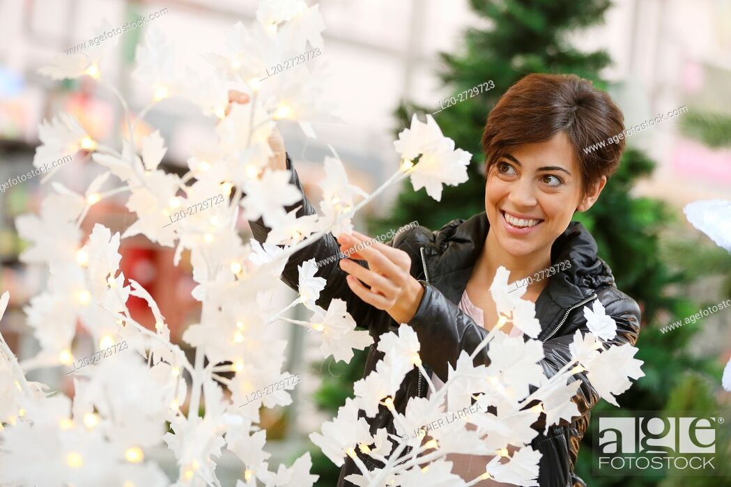 Stock Photo: woman buying Christmas tree, garden center.
