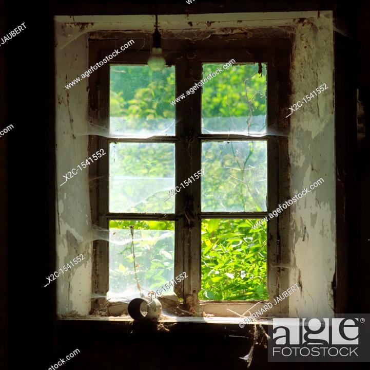 Stock Photo: Old window of a derelict house.