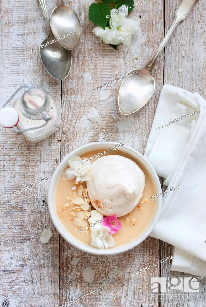 Stock Photo: Estonian apple soup with meringue, cream and almonds.