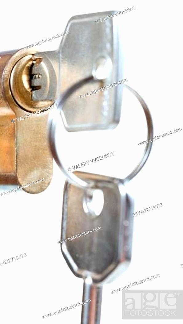 Stock Photo: bunch of home keys in cylinder lock.