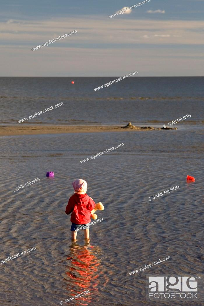 Stock Photo: Kid in Water on Pärnu Beach, Estonia, Europe.