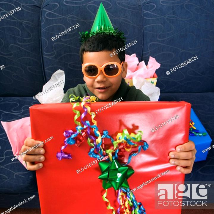 Stock Photo: Boy wearing party hat and sunglasses.