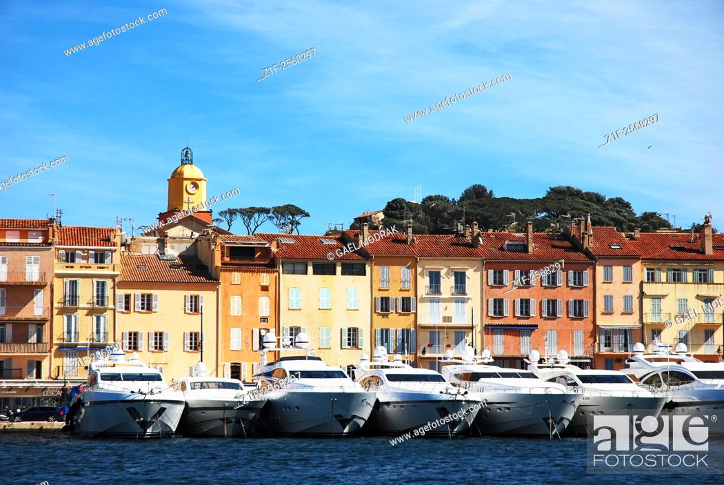 Stock Photo: Yachts parked behing houses in the village of Saint-Tropez, French riviera.